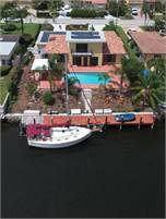 Deep water direct ocean access 4/4/2, swimming pool, solar collectors, impact windows, new roof